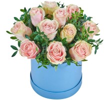 11 pink roses in a box